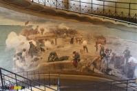 Überall Wandbilder die von einer Schlacht erzöhlen
